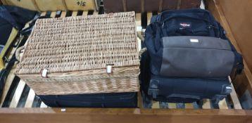 Eastpak backpack, a Samsonite cabin suitcase, a Fila cabin suitcase, a wickerwork picnic basket