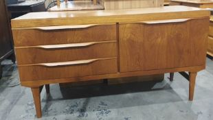 20th century teak sideboardwith three drawers to the left and teak fall-door to the right, 134cm