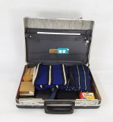 Metal attache case containing college scarves, notebooks, stud box with studs, bow ties, etc