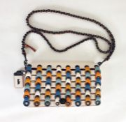 Coach cross-body turn-lock bag with patterned front flap, blue, cream, ochre, turquoise and orange