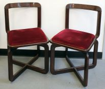 In the style of Willy Rizzo, a set of four, circa 1970, chestnut framed board room chairs, with