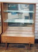 Pair of 20th century Turnidge teak lounge display cabinets, the two sliding glass doors enclosing