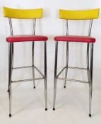 Pair of 20th century bar stools with yellow backs, red seats and chrome frames (2)