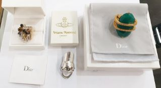 Christian Dior gilt metal costume ring with large green faceted oval stones, held by two bands of