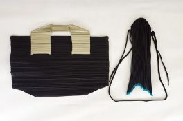Issy Miyake pleat bags late 1990's, one with turquoise detail, inverted  shape, draw-string, the