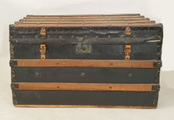 Wooden batoned black leather and studded steamer-type trunk, either end emblazoned with the initials