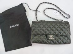 Chanel vintage quilted bagin black, turn lock fastening with Chanel logo, burgundy lining printed