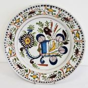 Old continental maiolica charger with stylised floral and birdcage design in aubergine, yellow