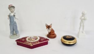 Royal Doulton model of a fox, a Lladro figure of a boy wearing a cap and dressed in blue