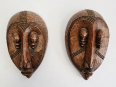 Pair of African masks marked 'Loute'