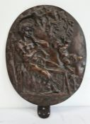 19th century bronze relief plaque of a satyr playing an instrument with a cherub beside him, oval,