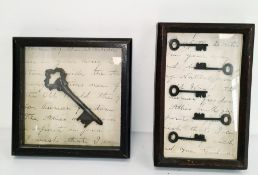 Two framed and glazed antique style keys