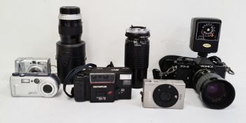 Collection of various digital cameras, lens, pouches, cases etc. ( 1 box)