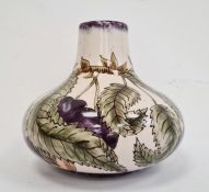 Cobridge squat baluster-shaped vase decorated with plums on vine, marked to base 'RB' and 'GP',