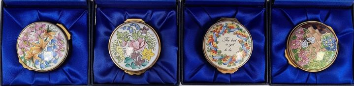 Four Kingsley enamel patch boxes, circular and floral decorated, all boxed