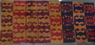 Eastern-style rugwith hooked motif, in reds, oranges and blues, 180cm x 80cm together with one