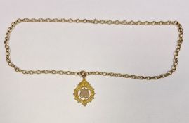 9ct gold 'Metropolitan Academy of Music' medal dated 1926 and a 9ct gold oval link chain bracelet,