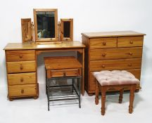 Modern pine chestof two short over three long drawers, a dressing table, a three-part mirror, a