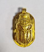 Yellow gold-coloured Egyptian pendant in the form of rounded oblong tablet embossed hieroglyphics,