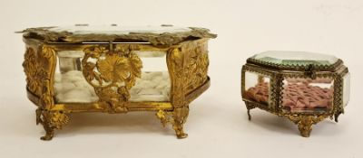 Two brass and glass jewellery boxesCondition ReportThe cushion inside the bigger one is frayed as