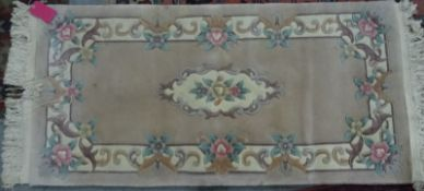 Chinese runnerand one further carpet(2)