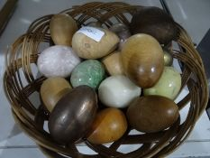 Collection of onyx and carved wooden eggs together with an oak carved hanging wall cupboard