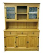 20th century oak dresserwith moulded pediment above two lead glazed doors, central open shelves,