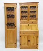 Modern light oak bureau bookcase, the moulded pediment above leaded glazed doors enclosing