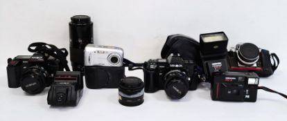 Two boxes comprising various digital and other cameras to include Minolta, Olympus, flashes, lens,