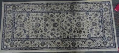 Cream ground modern rug, 175cm x 80cmand one further, red ground, 177cm x 80cm(2)