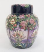 Moorcroft ginger jar decorated on a purple ground with white flowers and trees, marked to base '