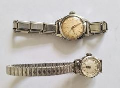 Lady's Omega stainless steel wristwatchwith faceted bezel and a lady's Omega stainless steel