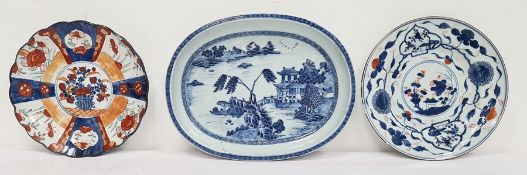 18th century Chinese porcelain shallow dish, rounded oblong with pagoda in lakeside landscape, in