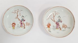 Pair antique Chinese porcelain saucers, each painted with two figures beside tree and sheep, 13cm