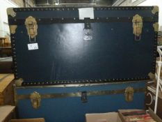 Two large canvas and metal-banded travelling trunks(2)