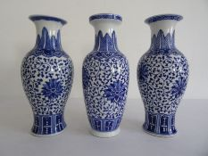 Near pair of Chinese porcelain baluster vases with underglaze blue decoration of flowerheads, on a