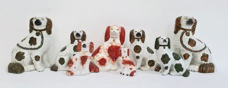 Collection of Staffordshire pottery spanielsto include pair copper lustre decorated spaniels, a