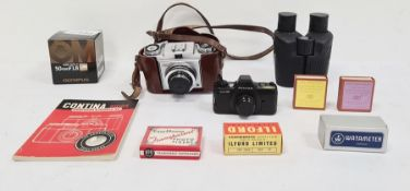 Zeiss Ikon camera in leather case, a Olympus 50mm F1.8 zoom lens and various other camera equipment