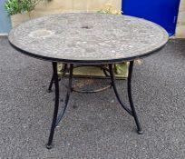 Circular topped mosaic garden table Condition Report