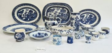 Pair Masons pottery cylindrical vases, willow pattern, sundry meat dishes and other blue and white