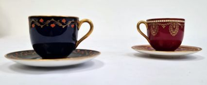 Two Royal Worcester demi-tasse and saucers, printed puce marks, date codes for 1929, the first