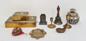 Two various brass cigarette boxes, an engraved elephant bell decorated with peacocks, a brass
