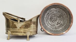Two 19th century brass hand-beaten, repousse swing-handled coal bucketon four splayed supports