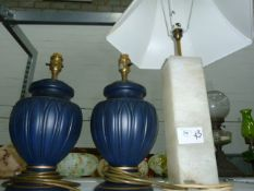 Pair of black ovoid-shaped ceramic table lamps, a large square alabaster table lampwith shade,
