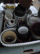 Large quantity of ceramic plant holders, a quantity of glassincluding Art Deco pink candlesticks,