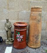 A painted chimney pot, another chimney pot and a garden figure of a monk with deer