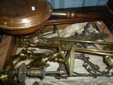 Various metalware including a brass trivet, fire irons, a copper warming pan, a pair of brass