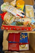 Two boxes of assorted items to include The Hummel Gold Christmas Ornament collection, Christmas tree