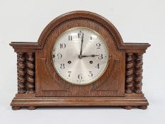 20th century oak-cased mantel clockwith Arabic numerals to the steel dial, marked 'Made in