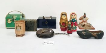 Collection of boxes to include a miniature metal safe with carry handle, a brass candleholder,